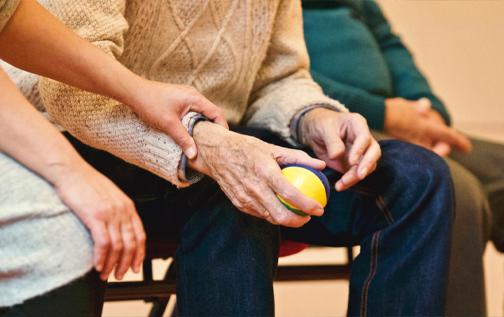 Woman holding elderly man's arm