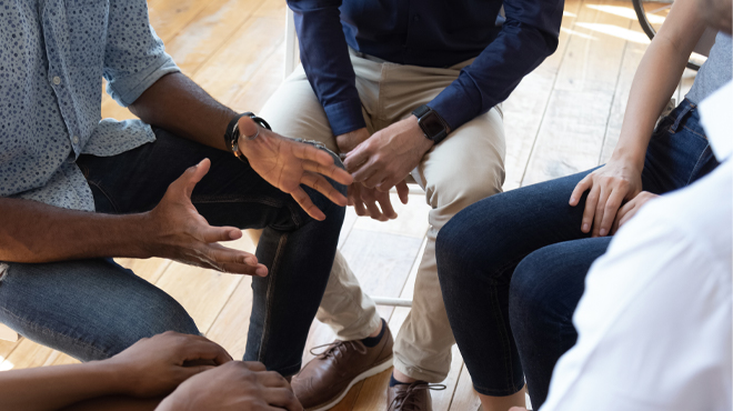 Support group talking in a circle